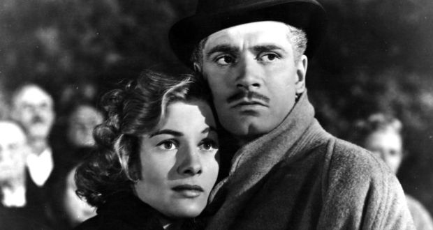 Laurence Olivier as Maxim de Winter with Joan Fontaine as his second wife